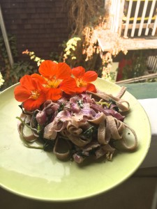 A delicious dish I made with fresh pasta and foraged nasturtium flowers and greens.